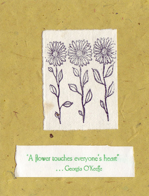 127 - 'A flower touches everyone's heart' on flocked yellow paper