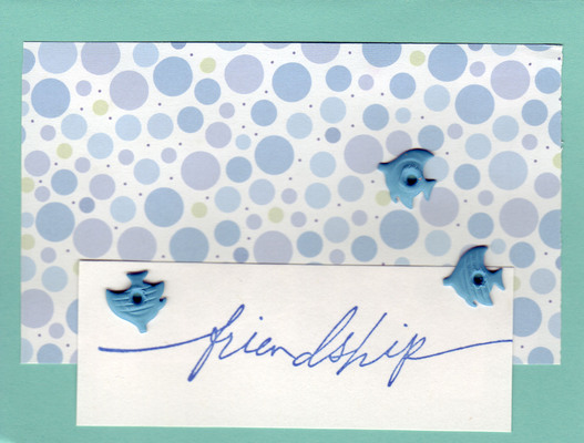 128 - 'Friendship' with fish brads on bubble dotted paper