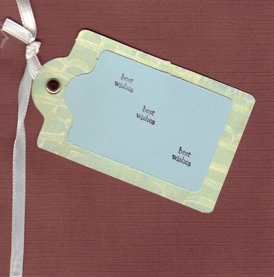 155 - 'Best Wishes' on a tag on deep maroon paper