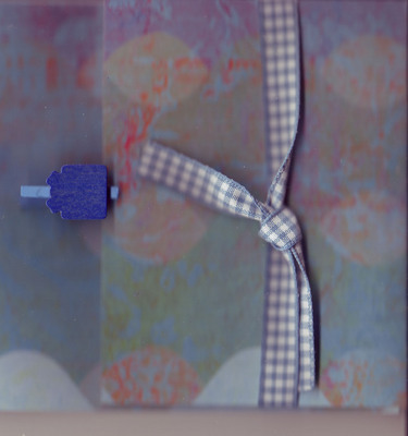 197 - (SOLD) Present clip on purple and red paper