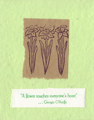 211 - 'A flower touches everyone's heart' with daffodil stamps on brown paper on a soft green textured card