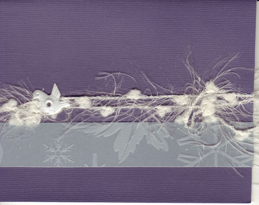 068 - A band of snowflake paper and snow-like thread held on to a deep purple card by a dove brad