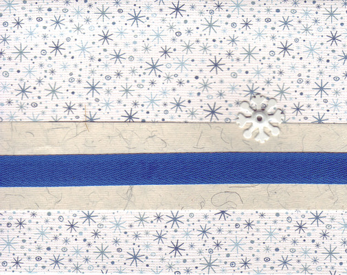 070 - A blue ribbon attached to a snowflake card by a metal snowflake brad