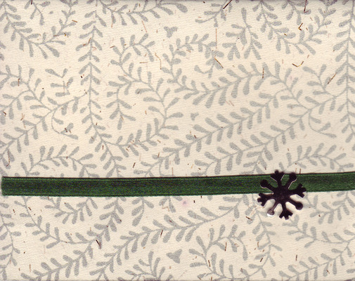 079 - Green ribbon attached to a richly textured card with fern print by a snowflake