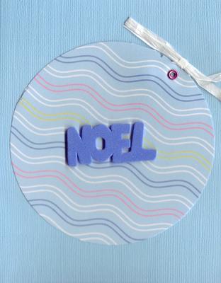 084 - Blue 'Noel' on wavy-paper ornament on blue card