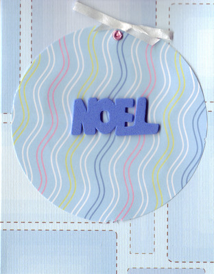087 - Blue 'Noel' on wavy-paper ornament on patterned blue card