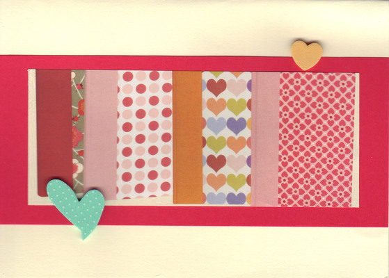 (SOLD)143 - Raised hearts on pink and red patterned paper