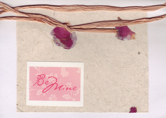 183 - 'Be Mine' on petal embedded paper with raffia ribbon