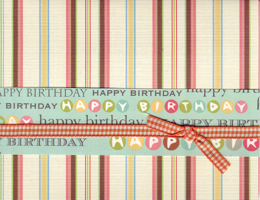008 - 'Happy Birthday' on festive striped paper with ribbon