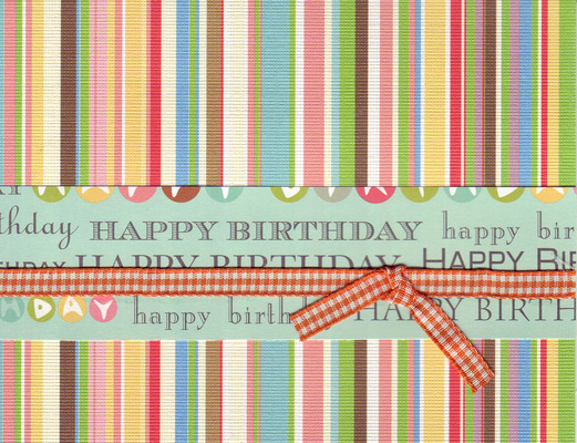009 - 'Happy Birthday' on festive striped paper with ribbon