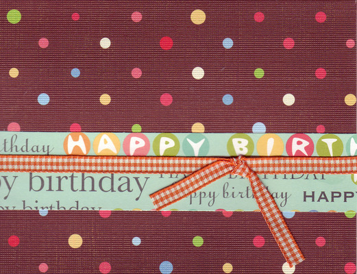 010 - 'Happy Birthday' on festive polka dotted paper with ribbon
