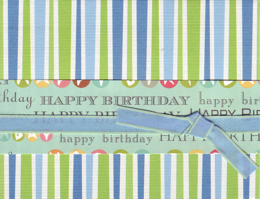 013 - 'Happy Birthday' on festive striped paper with ribbon