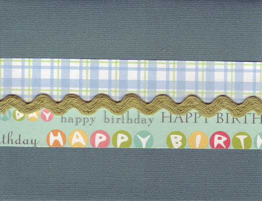 015 - 'Happy Birthday' on blue paper with ribbon