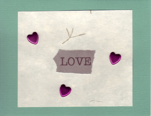 042 - 'Love' with hearts on green paper