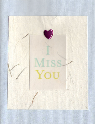 043 - 'I miss you' with heart on blue paper