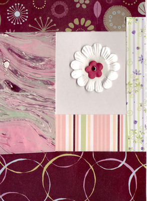 087 - Layered paper (floral, marbled, striped) with flower embellishment