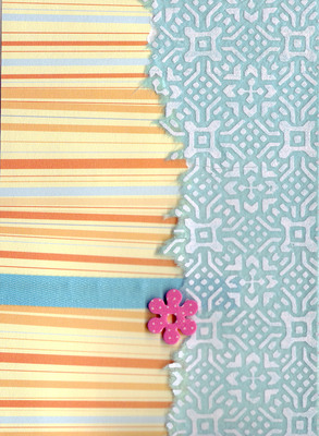 098 - Orange striped paper, with blue ribon and overlaidd elegnatly patterned paper with flower embellishment
