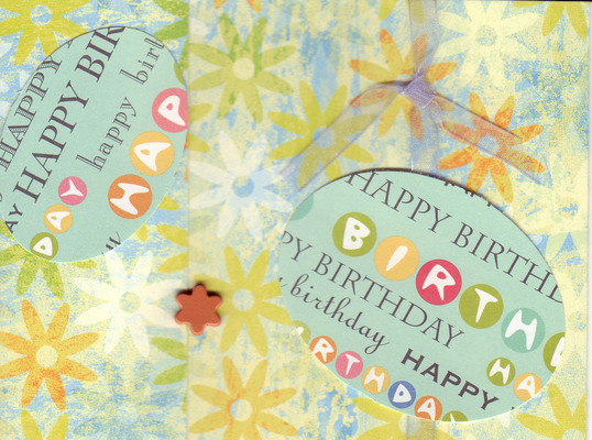 101 - 'Happy Birthday' on green and purple floral paper with ribbon and flower embellishments