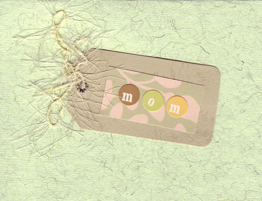 017 - (SOLD) 'Mom' on a pink, green and brown tag on green flocked paper