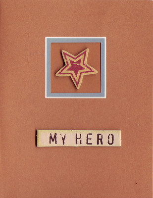 132 - 'My Hero' on a red card with a framed  star embellishment