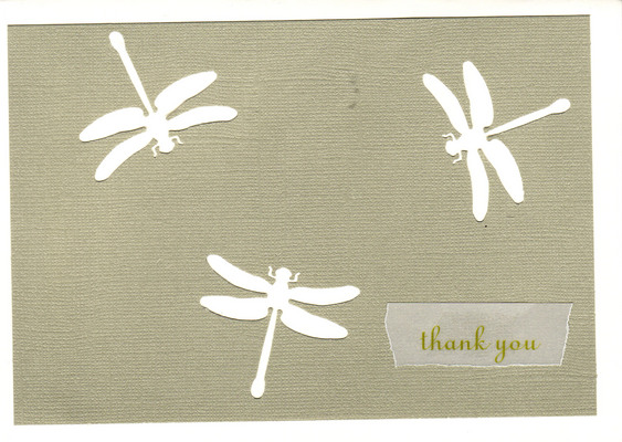 148 - 'Thank you' atop natural colored paper with dragonfly cutouts on a white card