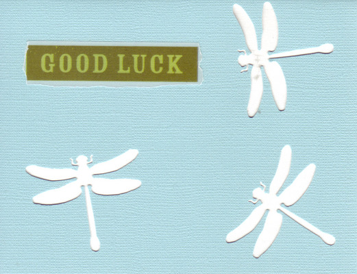 154 - 'Good Luck' on a sky-blue card  with dragonfly cutouts