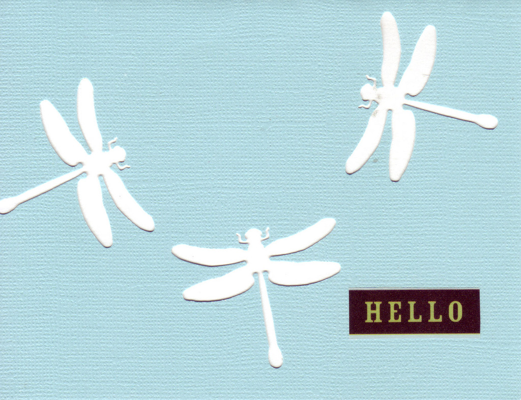 152 - 'Hello' on a sky-blue card  with dragonfly cutouts