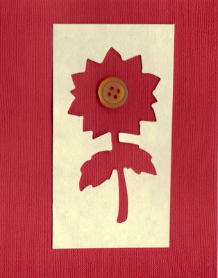001 - Textured red paper with overlaid ivory paper with a large flower cut-out and button