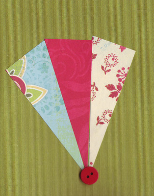 021 - Paper fan with button over deep green card