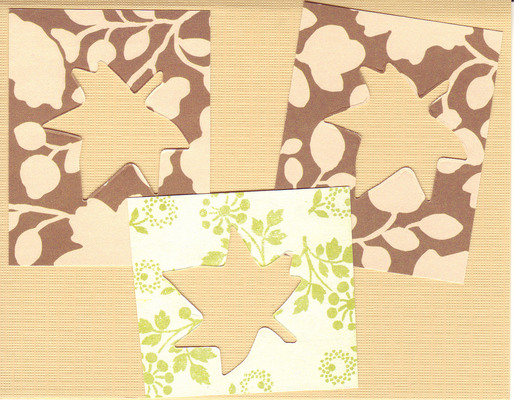 003 - Leaf cutouts from autumnal paper, on a light orange background